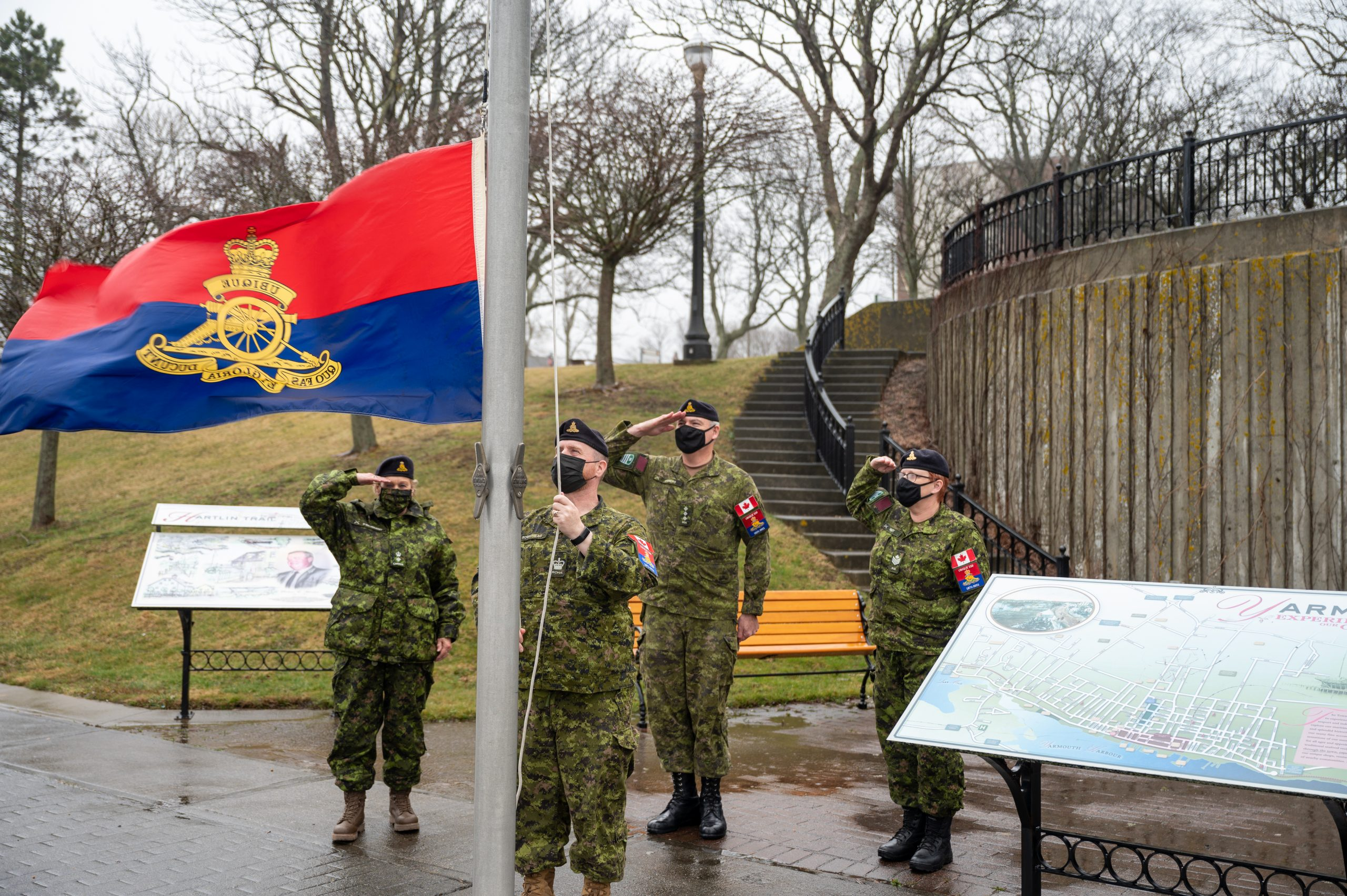 : Members of 84th Independent Field Battery, RCA raise The Royal Regiment of Canadian Artillery Flag at the Yarmouth Town Hall, NS.