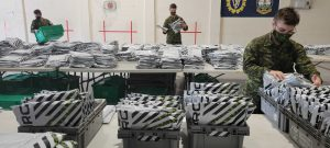 Army Reservist packing race kits